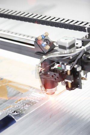 CNC Laser cutting machine cutting acrylic plate
