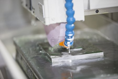 operator grinding surface of mold and die parts