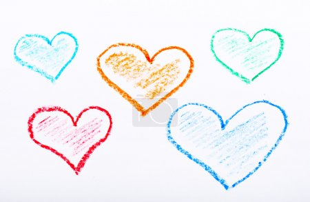 Pencil drawn hearts with different colours on white paper