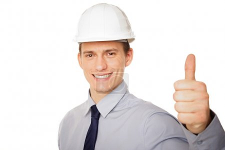 Businessman shows thumb up sign