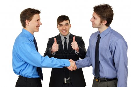 Photo for Young people shaking hands, finishing up a meeting - Royalty Free Image