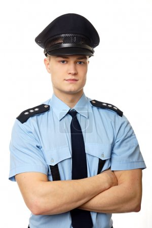 Young policeman with folded hands