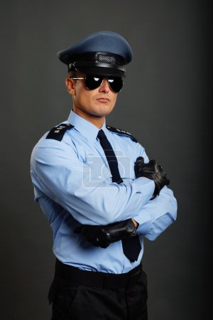 Policeman with folded hands