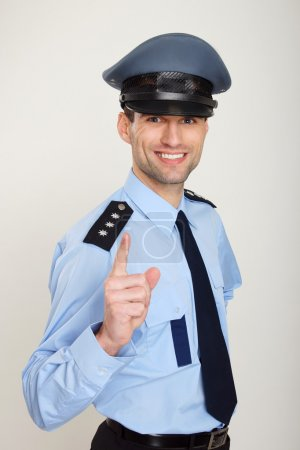 Policeman gesturing thumb up sign
