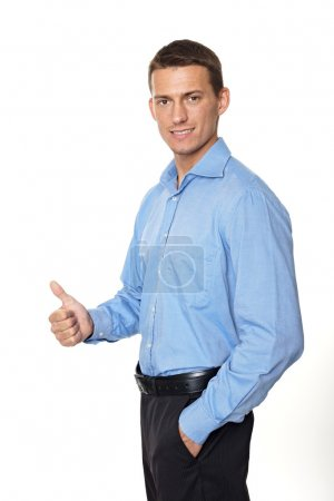 Photo for Young smiling businessman shows thumb up sign on white background - Royalty Free Image