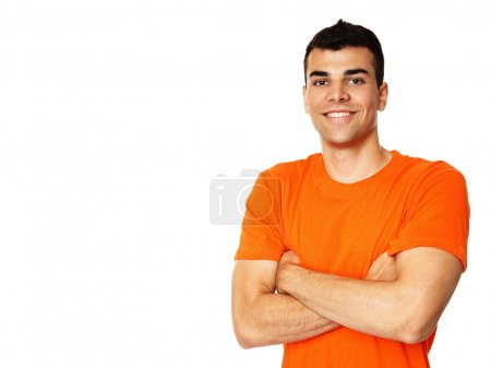 Photo for Portrait of young man in orange shirt with hands crossed posing on white background - Royalty Free Image