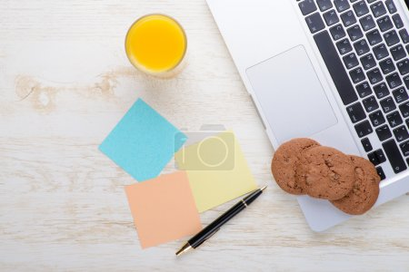 Laptop on a table with cookies