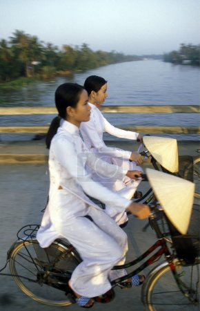Photo for People riding a bikes in Ho Chi Minh, Vietnam - Royalty Free Image