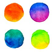 Set of 4 round watercolor colorful paint stains isolated on white background