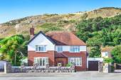 Traditional british house and beautiful mountains view