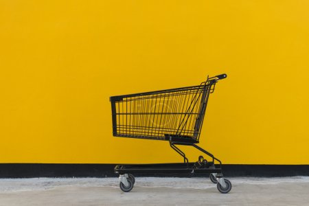 Minimalism style, Shopping cart and yellow wall.