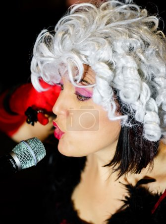 Christel Kern singing chanson. Portrait of french actress. Scene