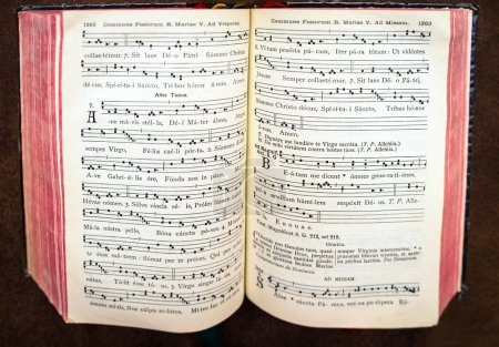 Vintage psalm book with chorus singing notes