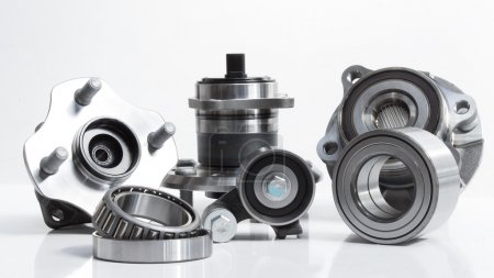 Various bearings lie on a gray