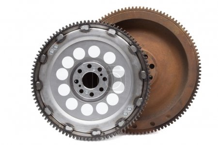 new and old rusty damping flywheels for automotive diesel engines on a white. car parts