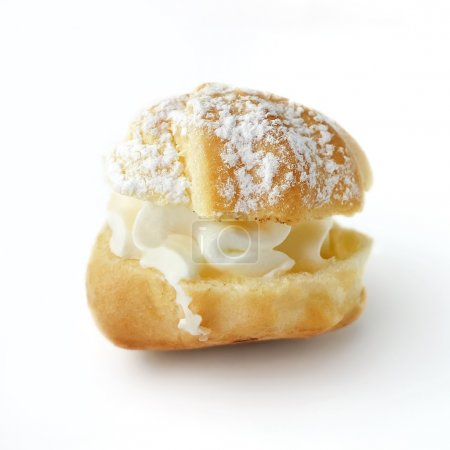 Photo for Cream puff or profiterole cakes with filling and powdered sugar topping, isolated, against white background - Royalty Free Image