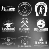 Set of monochrome vintage blacksmith labels and design elements on a blurred background Vector illustration