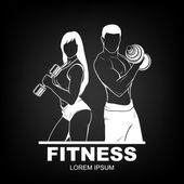 Beautiful fitness young sporty couple with dumbbells