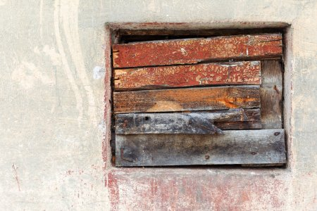 Window culled old wooden board on the wall with scratches and cr