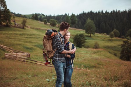 A couple hikers Hiking with backpacks