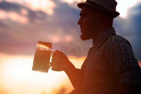 Happy smiling man tasting fresh brewed beer