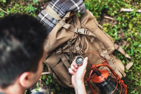 Man holding a compass.The concept of navigation, leisure.
