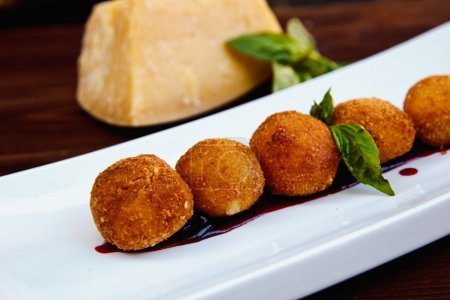 Cheese croquettes (Cheese breaded Camembert with b...