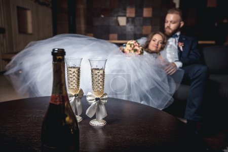 Glasses of champagne bride with groom