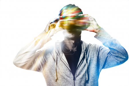 Double exposure of man using the virtual reality headset