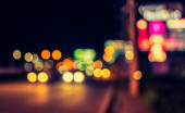 vintage tone image of blur street bokeh with colorful lights in night time for background usage .