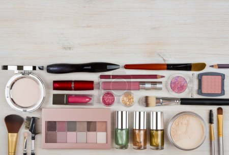Composition of makeup products and cosmetics on table with copyspace