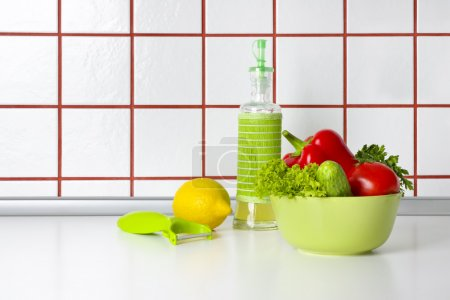 Photo for Vegetables, oil and scraper on kitchen counter background - Royalty Free Image