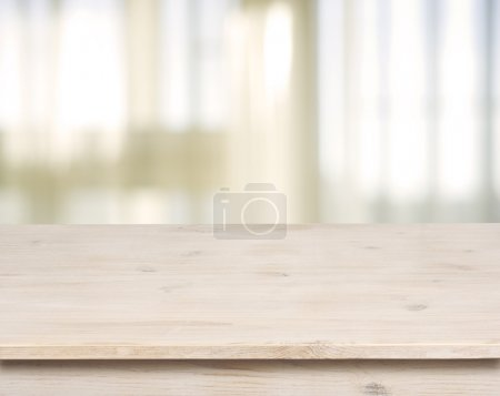 Photo for Wooden table on defocuced window with curtain background - Royalty Free Image