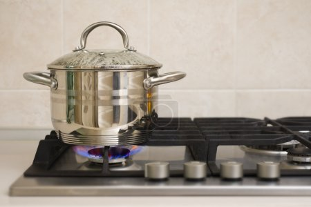 Boiling pot on the gas stove fire
