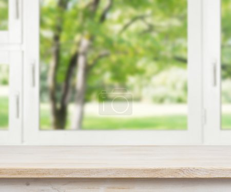 Photo for Wooden table over summer window background - Royalty Free Image