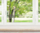 Wooden table over summer window background