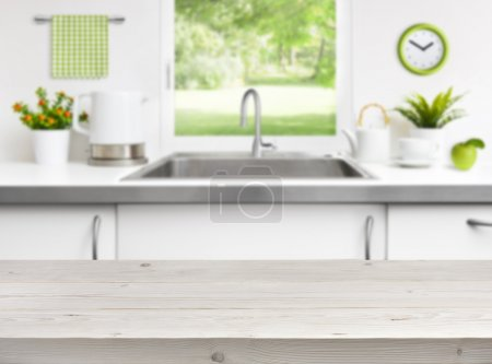 Wooden table on kitchen sink window background...