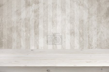 Photo for Empty wooden planks table top over grunge wall background - Royalty Free Image