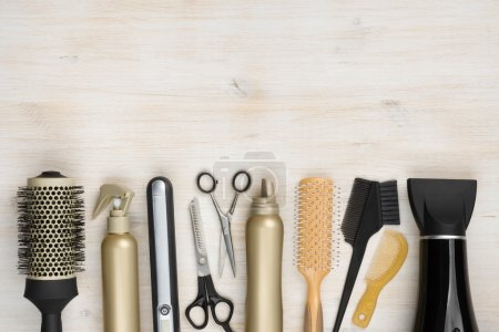 Hairdressing tools on wooden background with copy ...