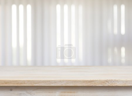 Photo for Wooden table on defocuced window with jalousie background - Royalty Free Image