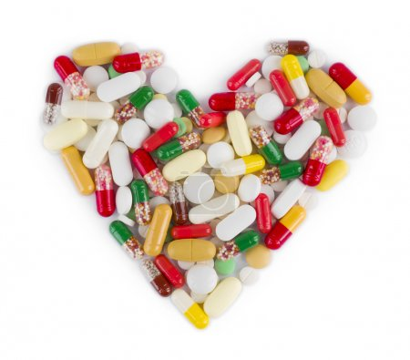 Heart shape made from medicine capsules, pills and tablets