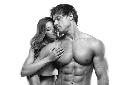 Muscular man holding a beautiful woman
