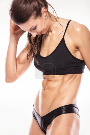 fitness woman showing abdominal muscles