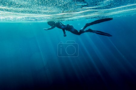 Photo for Freediver in wetsuit neoprene swim in the sea - Royalty Free Image