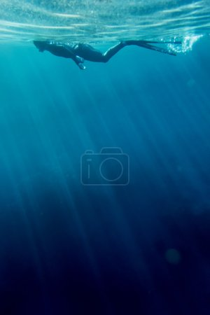 Freediver swim in the sea