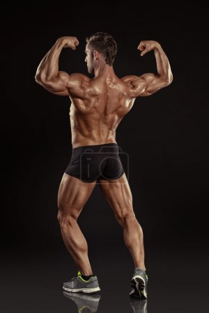 Athletic Man posing back muscles