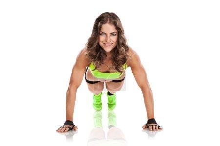 beautiful fitness young woman doing pushups