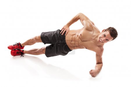 Muscular bodybuilder guy doing pushups