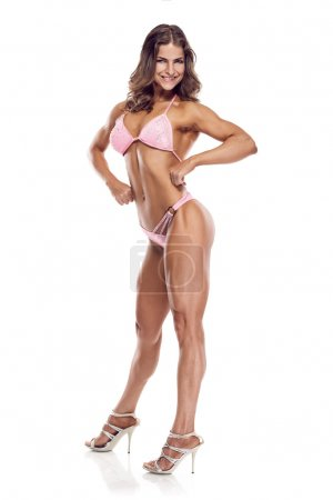 Photo for Posing woman bikini fitness competitor isolated on white background - Royalty Free Image
