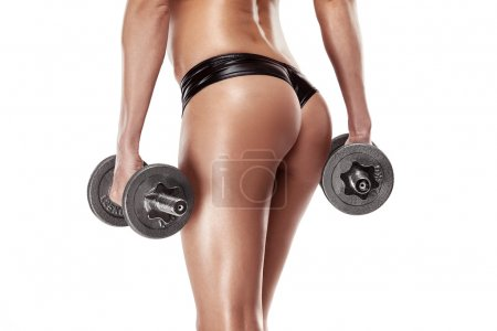 Sexy woman with dumbbells